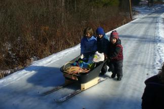 Wild Roots students transport supplies using their ski-sled.