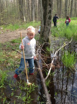 Children spend time outdoors daily, including searching for frogs in spring.